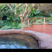 Treated Pine Sundeck, adjoining a rock pool.